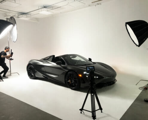 McLaren Video Shoot man shooting car staged on cyc wall